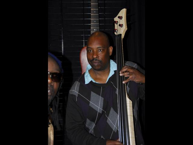 Raul Walton with a Fichter Electric Upright Bass
